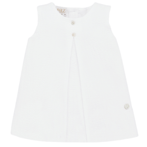 """Paz Rodriguez Dress """"Horizonte"""".Fresh and light cotton dress with round neckline by Paz Rodriguez. Dress with armhole sleeve, round neckline and a large pleat at the front, mother of pearl plate. Fastens at the back with buttons, fully lined with cotton lining."""