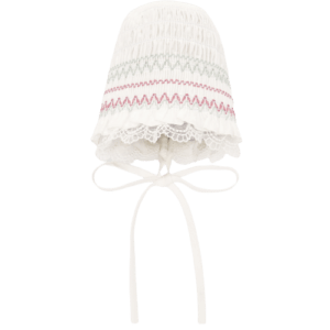 """Paz Rodriguez Bonnet """"Cascada"""". Ivory bonnet for baby girls by Paz Rodriguez, made in a soft fabric and have a green and pink embroidery. It has a lightweight cotton lining, with a lace trim and ribbon ties that fasten under the chin."""