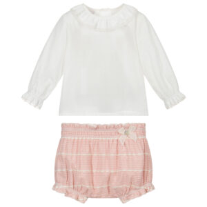 """Paz Rodriguez Set """"Vera"""". Ivory shirt and pink shorts set for baby girls by Paz Rodriguez. The smooth cotton blouse has a lace frilled collar and matching cuffs with back button fastening. The pink and ivory shorts have lace embroidery and an elasticated waist and leg holes."""