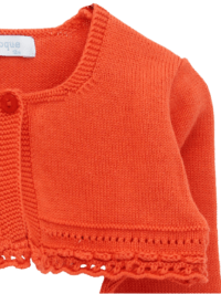 Foque Cherry Knitted Cotton Cardigan. Pale cherry cardigan for little girls by Foque, made in a soft, lightweight cotton knit. There is a single button fastening on the front.