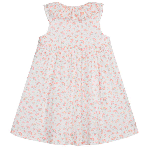 Foque Floral Dress Set. White dress for babygirls by Foque, made in soft, lightweight plumeti cotton, with a pretty orange floral print. Fully lined, in a cross-over style, it has a frilled collar and button fastenings on the front. Short cotton knit cardigan with round neckline and details worked on the sleeves and neckline. Fastens with a button in the color of the mesh. The cardigan is perfect for summer afternoons with cool breezes.