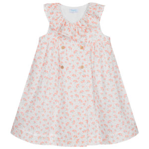 Foque Floral Baby Dress. White dress for babygirls by Foque, made in soft, lightweight plumeti cotton, with a pretty orange floral print. Fully lined, in a cross-over style, it has a frilled collar and button fastenings on the front.