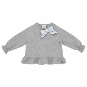 """Paz Rodriguez Cirl Set """"Confort"""". Younger girls grey trousers set from Paz Rodriguez, made in mid-weight cotton jersey with a raised zigzag pattern. The top The top tightens at the back and has a bow and a small frill that embellish the set. The trousers have an elasticated waistband and turned-up cuffs."""