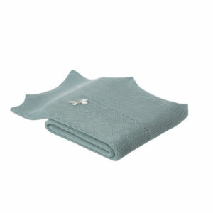 """Paz Rodriguez Shawl """"Salvia"""" . Green shawl for baby girls by Paz Rodriguez, made in a soft acrylic knit. Soft and mid-weight, it has pretty scalloped edges and a white bow, with a mother-of-pearl logo disc in one corner."""