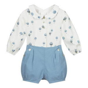 """Paz Rodriguez Ballon Set """"Caricias"""". Adorable ivory and blue cotton shorts set for baby boys by Paz Rodriguez. The cotton twill shirt has a blue hot air balloon print, faux buttons on the front and button fastenings on the back. The blue lightweight cotton shorts have an elasticated waistband and leg openings and two faux side pockets, with decorative buttons."""
