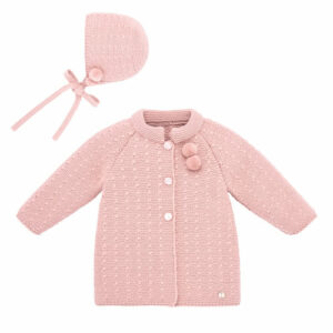 """Paz Rodriguez Coat Set """"Salvia"""". Pink coat for baby girls by Paz Rodriguez, knitted in soft Merino wool. It has pom-pom trims on the front and button fastenings. Sweet pink bonnet for baby girls by Paz Rodriguez. Made in softly knitted Merino wool, it has pom-pom trims and knitted ties that fasten under the chin."""