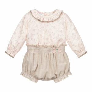 """Paz Rodriguez Floral Set """"Baul"""". Sweet pink and beige shorts set for baby girls by Paz Rodriguez. The pink blouse is made in soft and lightweight cotton twill. It has a beige and lilac floral print and a pretty ruffled collar and cuffs, with beige lace trim. The lightweight beige shorts have elasticated trims with pink embroidered detail, and a satin bow with mother-of-pearl logo tab."""