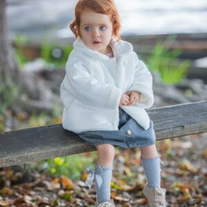 """Paz Rodriguez Jacket """"Caricias"""".Ivory faux fur coat, inside and collar, for girls by Paz Rodriguez. Cozy and comfortable, it's made with super-soft fabric and lined with faux fur for added comfort. It has a mother-of-pearl logo on the hem and pearl buttons on the front."""