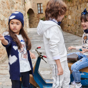 Monnalisa Kids Bambi Hooded Top. Tender cartoon print for this long sweatshirt, embellished by a maxi ruffle on the hem, hood in contrasting fabric. It is printed with a beige Disney© Bambi motif with sparkly blue diamanté hearts on the front.
