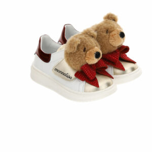 Monnalisa Kids Teddy Glitter Sneakers. These colorful sneakers display unexpected details such as the applied Teddy bear and inserts in mixed materials. Girls white leather trainers from Monnalisa, with gold and red patent trim. They have a red diamanté bow and brown faux fur teddy bear on the velcro fastening strap. They are lined in leather and have a shaped leather inner sole and non-slip rubber outer sole.