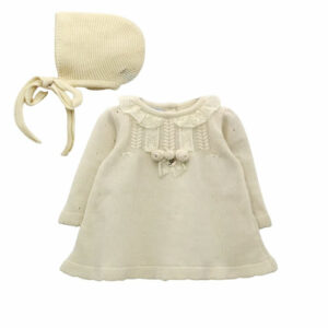 Foque Baby Pearl Dress Set. Lovely dress for little girls. Lovely dress for little girls. The dress, in knitted wool, has small details in lace and worked mesh. The detail of three small flowers and a small mother-of-pearl medal stands out. To complete this sweet look, it comes with matching bonnet. The dress fastens at the back, with mother-of-pearl buttons, for your baby's comfort and safety.
