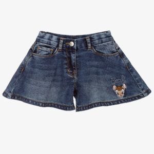 Monnalisa Kids Denim Disney Shorts. Girl shorts in practical denim, with a fluid line like skirt-pants. Girls dark blue washed denim shorts, with a cute Disney© Bambi embroidered on one leg. Made in soft and stretchy cotton blend jersey denim, they have super wide, flared legs with soft faux leather trims around the inside hem and a navy blue logo patch on the back.