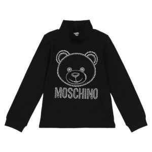 Moschino Kids Teddy Bear Turtleneck Sweater. Embellished with a teddy bear motif accompanied by the label's logo, this black sweater from Moschino Kids features long sleeves, a high neck and is crafted from cotton with a slight stretch.