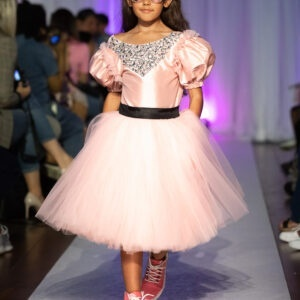 Melis Kaptanoglukids Pink Diamond Dress.Dress in silk and tulle. Soft silk top with delicate crystal decorated the neckline. Part of the skirt made of silky, flowing tulle. Zippered from the back, it has a smooth silky linings.